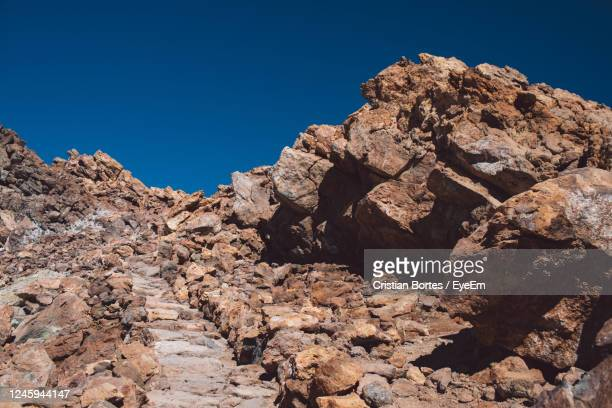 low angle view of rock formation against clear blue sky - bortes stock pictures, royalty-free photos & images