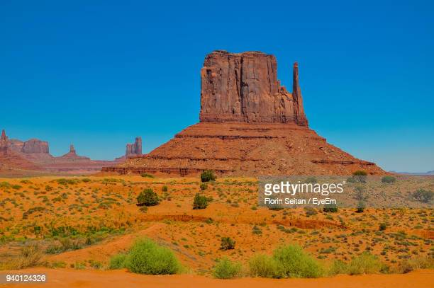 low angle view of rock formation against clear blue sky - florin seitan stock pictures, royalty-free photos & images