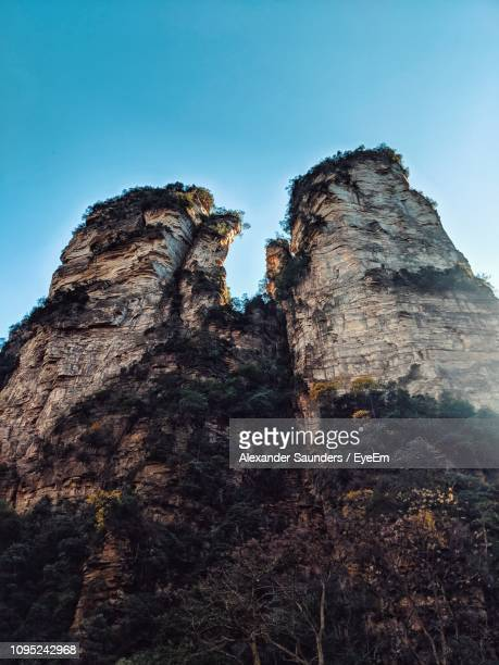 low angle view of rock formation against sky - cliff saunders stock pictures, royalty-free photos & images