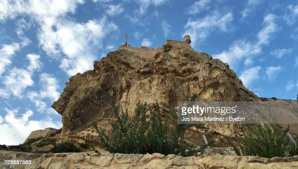 low angle view of rock formation against sky - mara martinez stock-fotos und bilder
