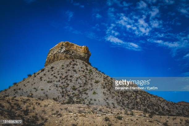 low angle view of rock formations against blue sky - chisos mountains stock pictures, royalty-free photos & images