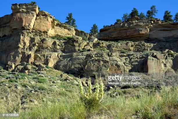 low angle view of rock formations against clear blue sky - billings montana stock pictures, royalty-free photos & images