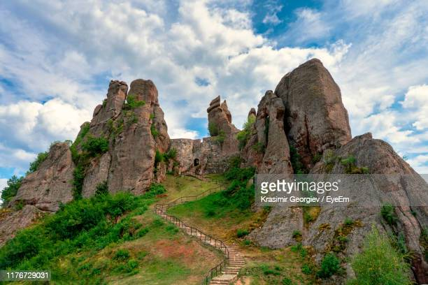 low angle view of rock formations against sky - krasimir georgiev stock photos and pictures