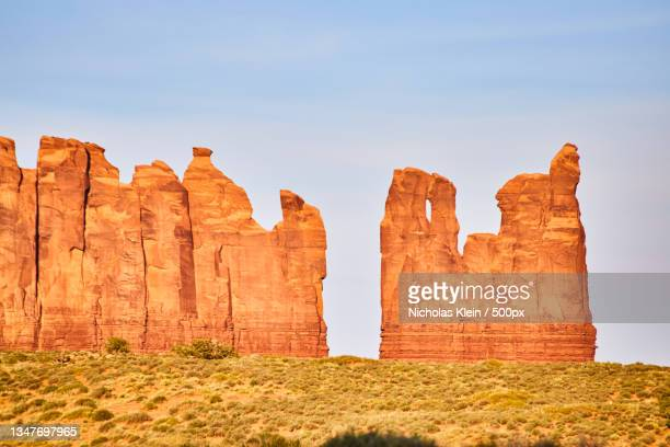 low angle view of rock formations against sky - klein stock pictures, royalty-free photos & images