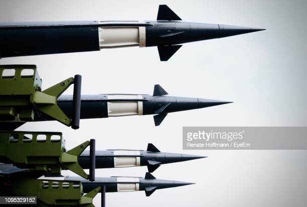 low angle view of rockets against sky - weaponry stock pictures, royalty-free photos & images