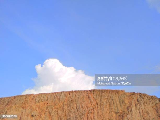 low angle view of rocks against blue sky - muhamad nasrun stock pictures, royalty-free photos & images
