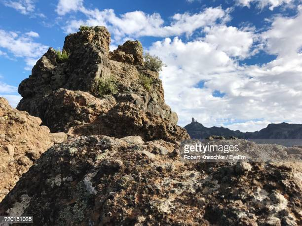 low angle view of rocks on mountain against sky - tejeda canary islands stock pictures, royalty-free photos & images