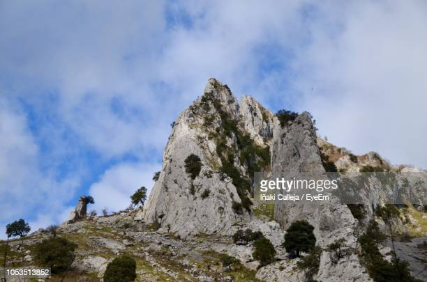 low angle view of rocky mountain against sky - iñaki mt stock photos and pictures