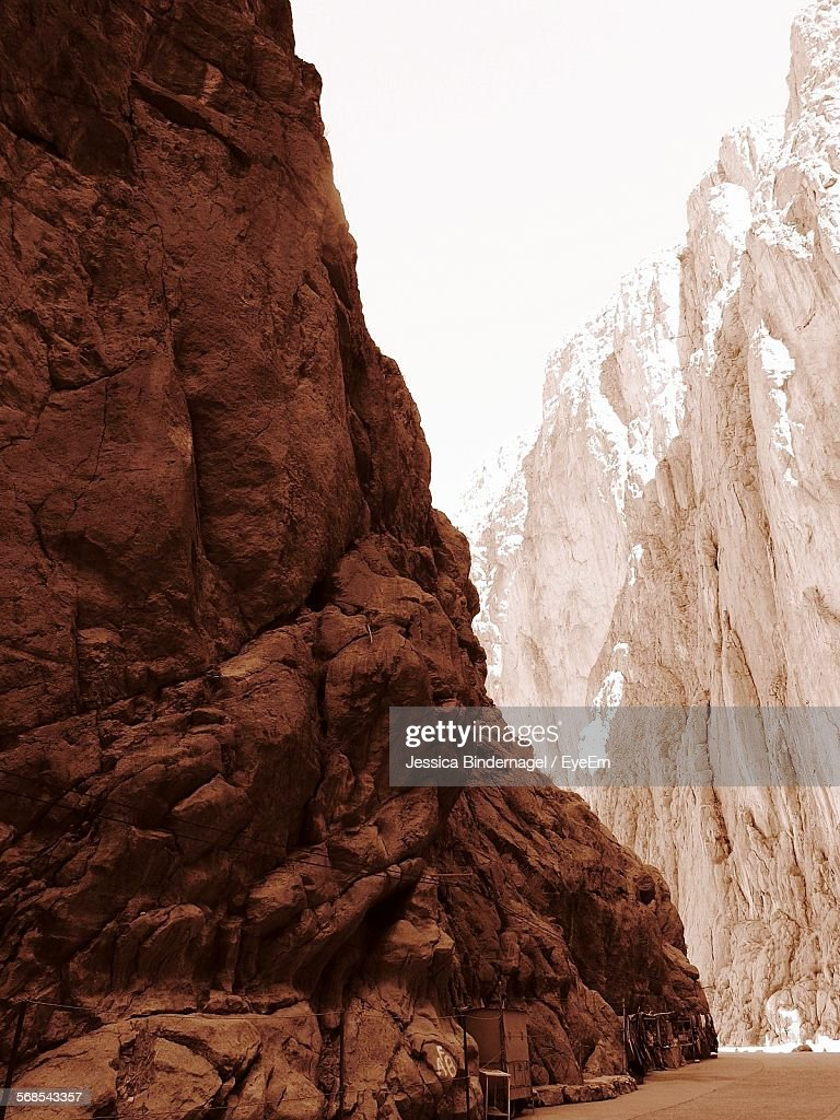 Low Angle View Of Rocky Mountains Against Clear Sky : Stock Photo