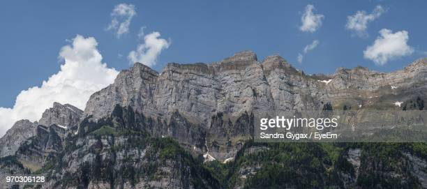 low angle view of rocky mountains against sky - sandra gygax stock-fotos und bilder