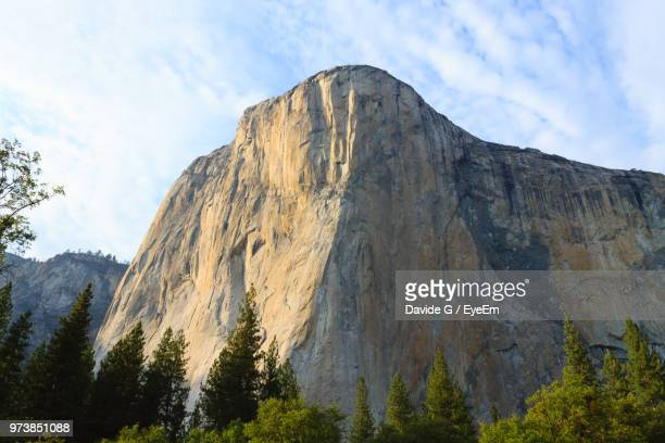 low angle view of rocky mountains against sky - steep stock pictures, royalty-free photos & images