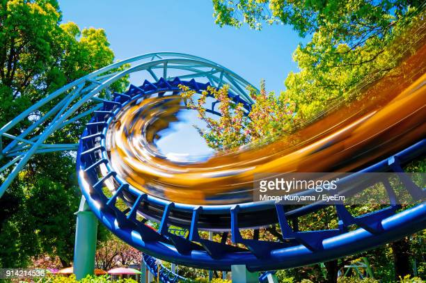 Low Angle View Of Rollercoaster At Amusement Park