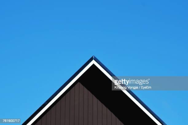 low angle view of roof against clear blue sky - roof stock photos and pictures