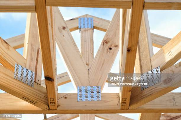 low angle view of roof against sky - lara rafter stock pictures, royalty-free photos & images