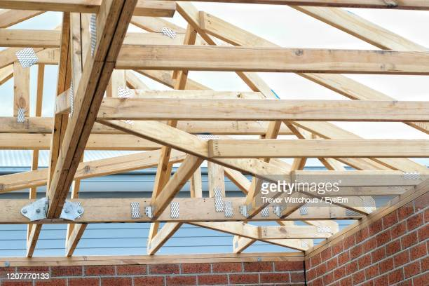 low angle view of roof framework - lara rafter stock pictures, royalty-free photos & images