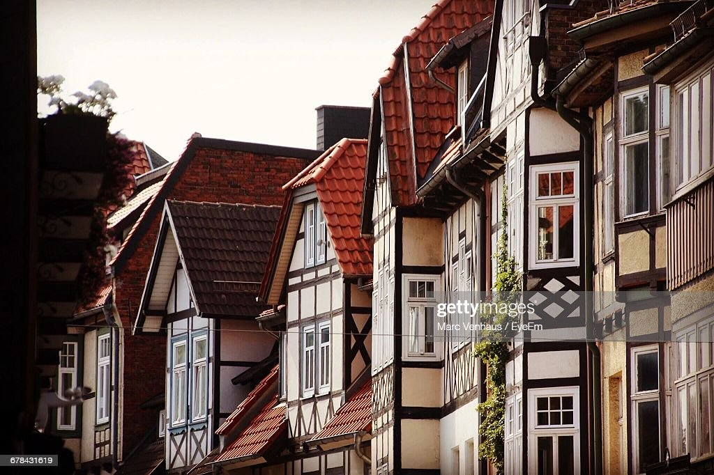 Low Angle View Of Row Houses In Town Against Clear Sky : Stock Photo