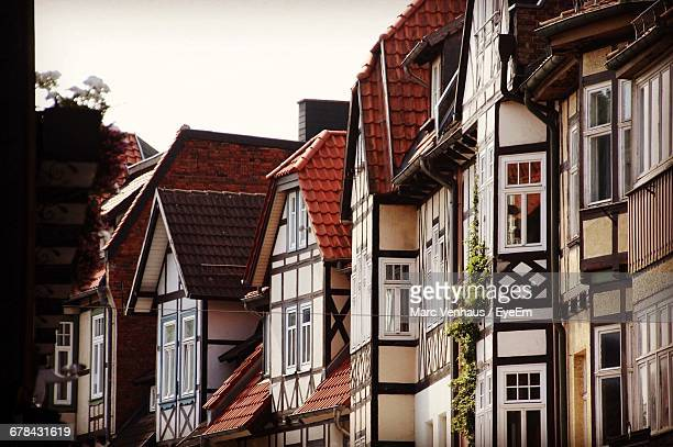 low angle view of row houses in town against clear sky - hanover germany stock pictures, royalty-free photos & images