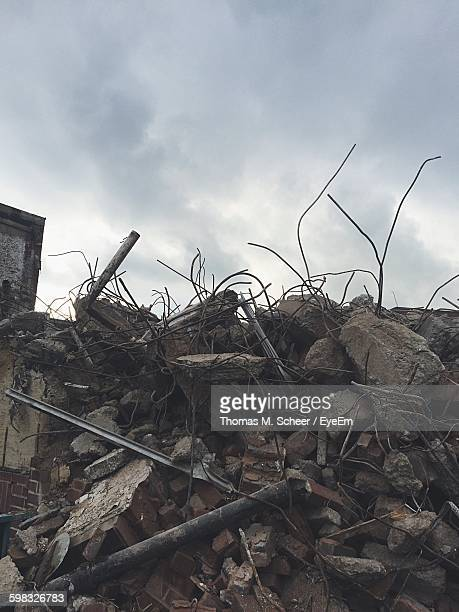 low angle view of rubble heap against sky - rubble stock pictures, royalty-free photos & images