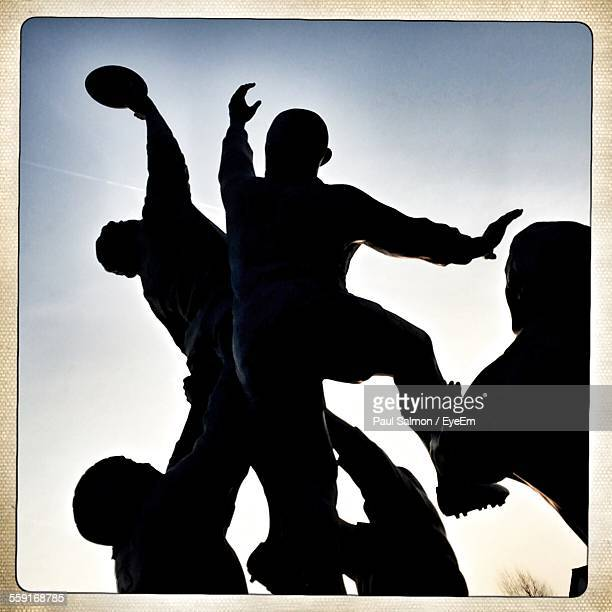 Low Angle View Of Rugby Lineout Statue Against Sky