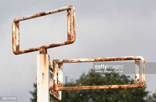Low Angle View Of Rusty Metallic Pole Against Clear Sky