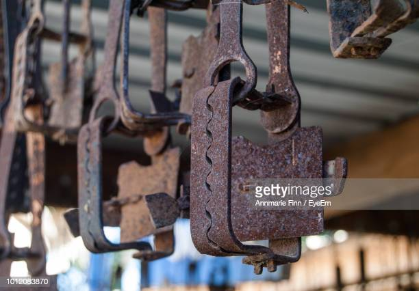 Low Angle View Of Rusty Metallic Traps Hanging Outdoors