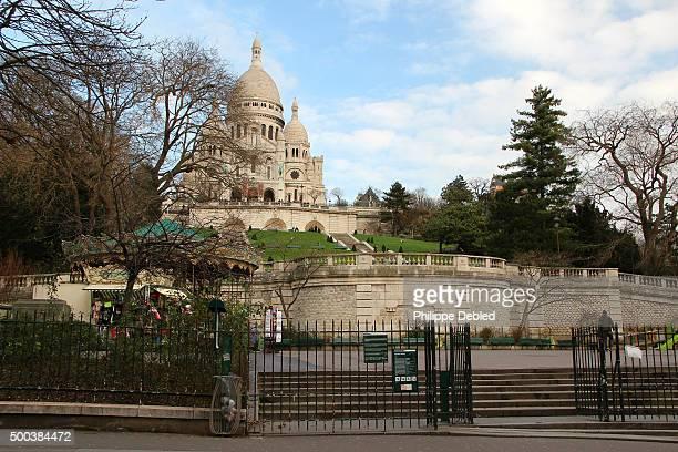 Low angle view of Sacré Coeur Basilica from main acess, Place Saint Pierre, 18th district, Paris