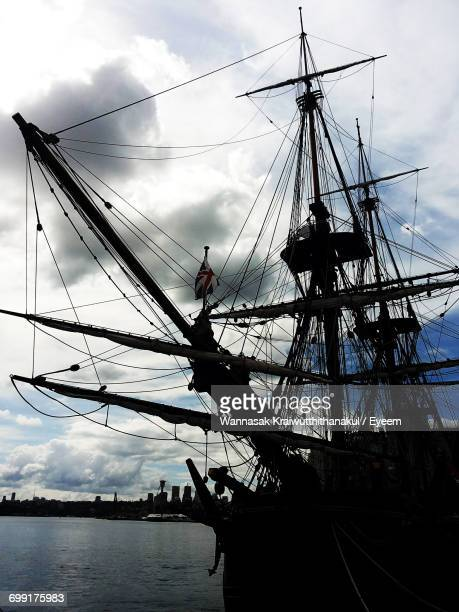 low angle view of sailboat in sea - galleon stock photos and pictures