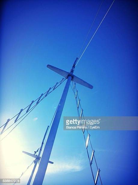 Low Angle View Of Sailboat Mast Against Clear Blue Sky