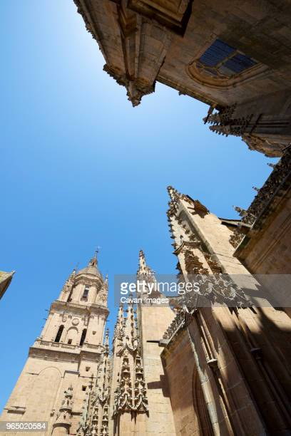 low angle view of salamanca cathedral against clear sky - monument stockfoto's en -beelden