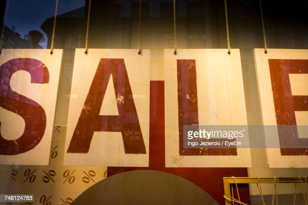 Low Angle View Of Sale Sign On Store Window