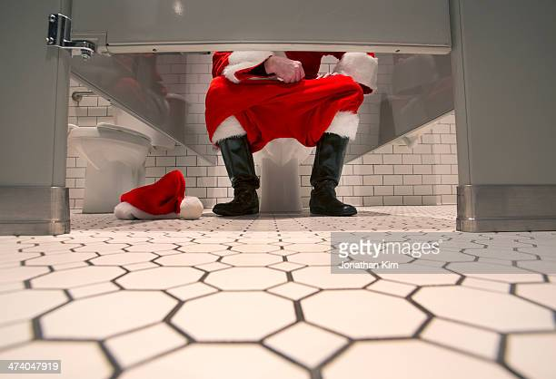 Low angle view of Santa in a bathroom stall