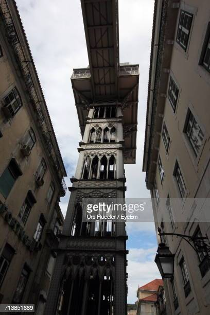 Low Angle View Of Santa Justa Lift Amidst Buildings In City