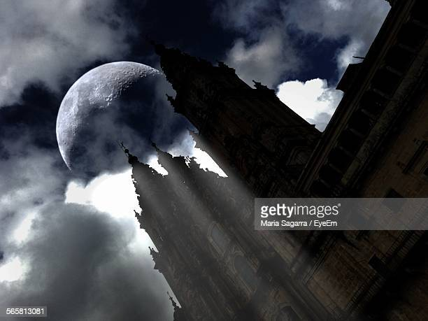 Low Angle View Of Santiago De Compostela Cathedral Against Moon