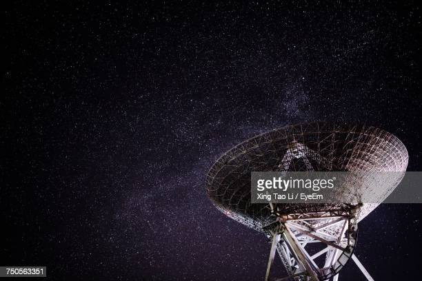 Low Angle View Of Satellite Against Sky At Night