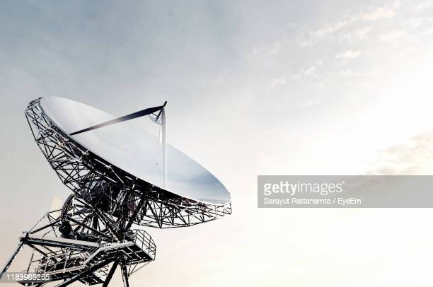 low angle view of satellite dish against sky - receiver stock pictures, royalty-free photos & images