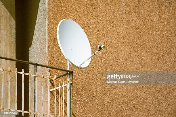 Low Angle View Of Satellite Dish On Building Balcony