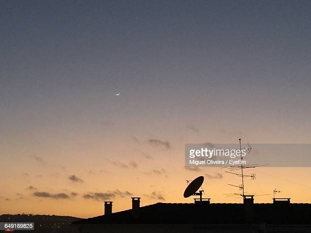 Low Angle View Of Satellite Dish On House Against Sky At Dusk