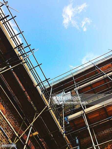 Low Angle View Of Scaffoldings Against Sky On Sunny Day