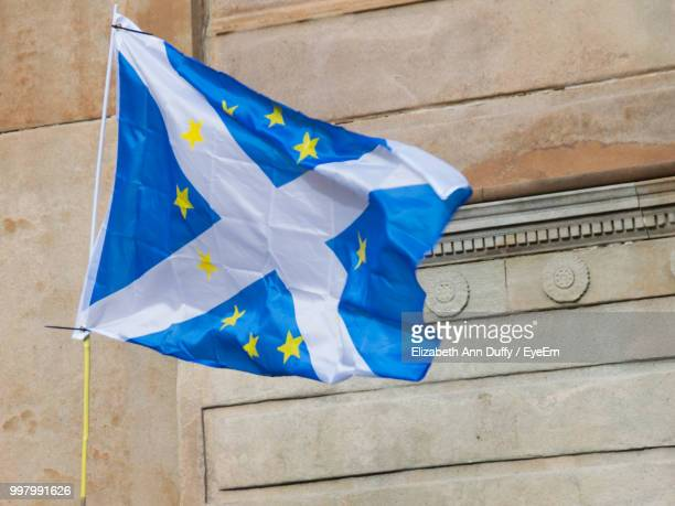 low angle view of scottish flag against wall - scotland flag stock photos and pictures