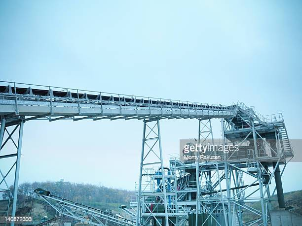 Low angle view of screening conveyor at quarry site