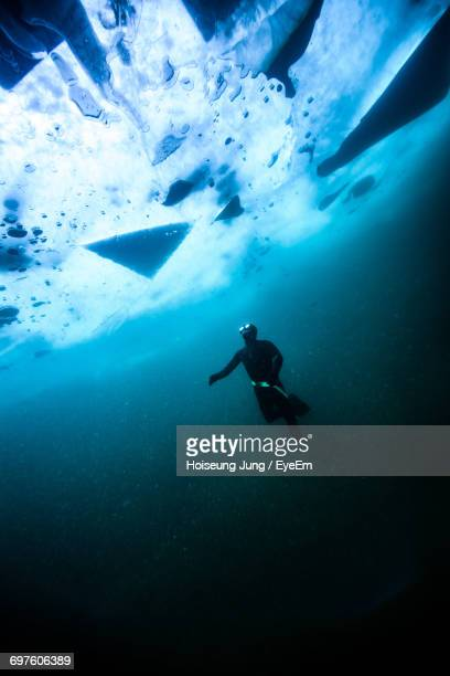 Low Angle View Of Scuba Diver Underwater