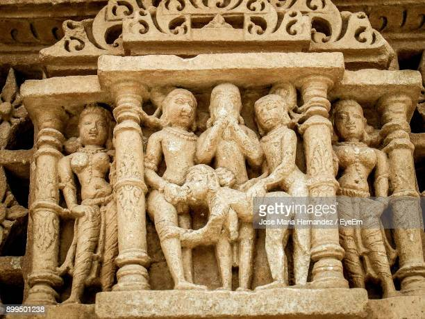 low angle view of sculpture of temple - bas relief stock pictures, royalty-free photos & images