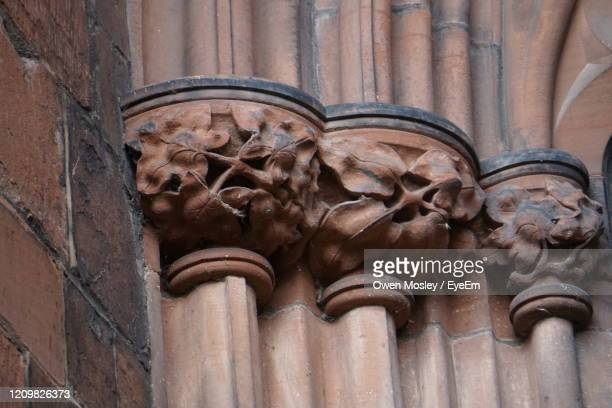 low angle view of sculpture on building - carlisle stock pictures, royalty-free photos & images