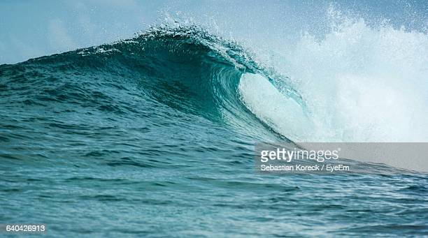 Low Angle View Of Sea Wave Against Sky