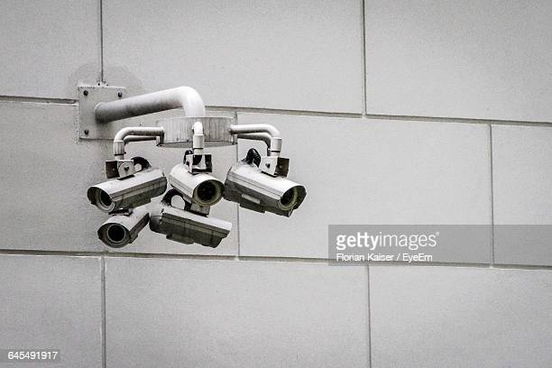 Low Angle View Of Security Camera On Wall