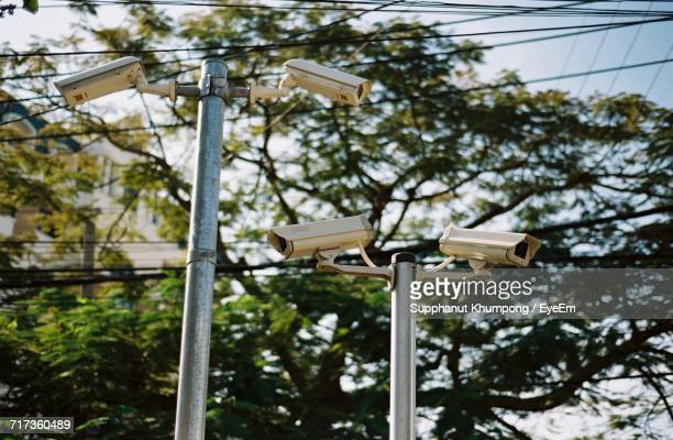 Low Angle View Of Security Cameras