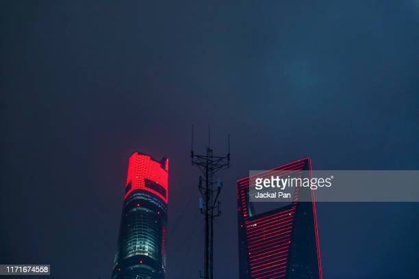 low angle view of shanghai landmark buildings against mobile signal tower at night - tower stock pictures, royalty-free photos & images