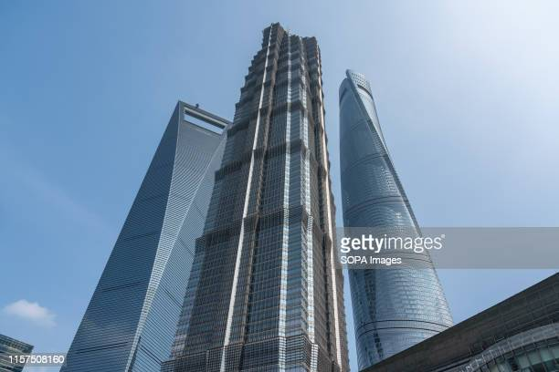 Low angle view of Shanghai World Financial Center, Jin Mao Tower and Shanghai Tower in Lujiazui, Shanghai.