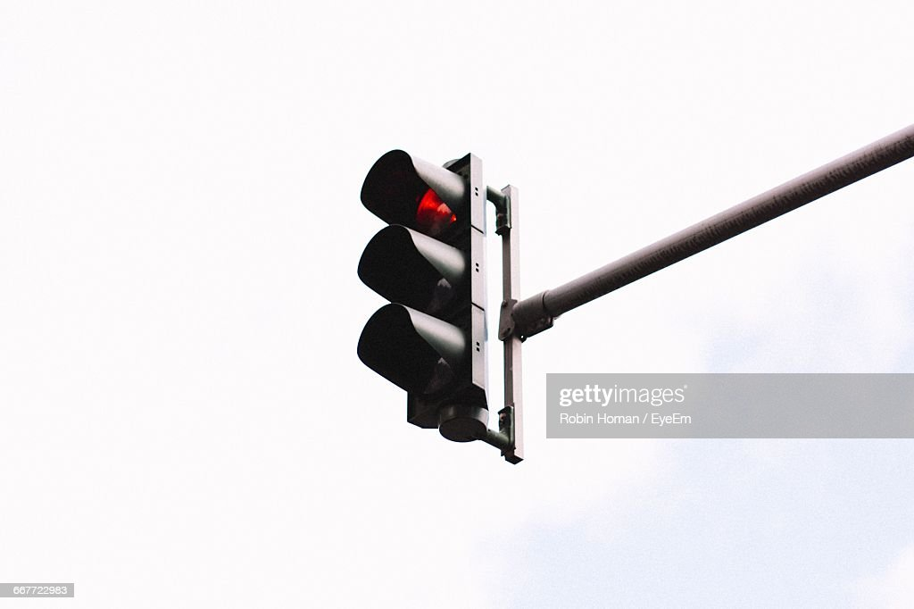 Low Angle View Of Signal Against White Background : Stock-Foto