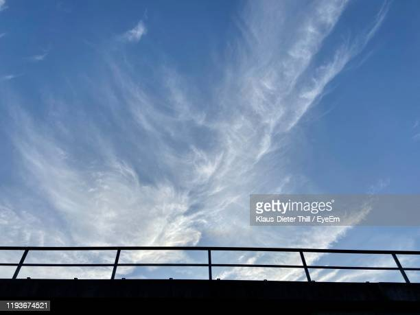 low angle view of silhouette bridge against blue sky - klaus-dieter thill stock-fotos und bilder